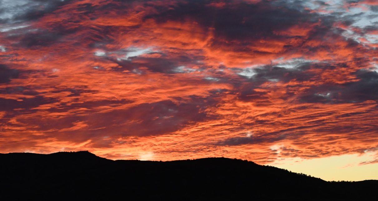 Et bilde som inneholder utendørs, himmel, solnedgang, natur Automatisk generert beskrivelse